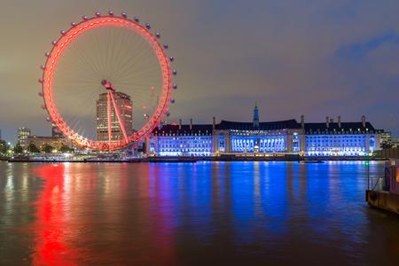 riverside county: LONDON, ENGLAND - JUNE 16 2016: Night photo of The London Eye and County Hall, London, England, Great Britain Editorial