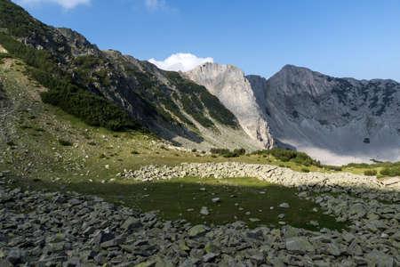Amazing Panorama of rocks of Sinanitsa peak covered with shadow, Pirin Mountain, Bulgaria Stock Photo