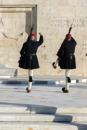 ATHENS, GREECE - JANUARY 19 2017:  Evzones - presidential ceremonial guards in the Tomb of the Unknown Soldier at the Greek Parliament, Athens, Greece