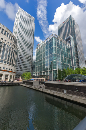 greenwich: LONDON, ENGLAND - JUNE 17 2016: Business building and skyscraper in Canary Wharf, London, England, Great Britain