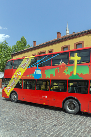 balkans: SKOPJE, REPUBLIC OF MACEDONIA - 13 MAY 2017:  A red double-decker bus passing through the streets of city of Skopje, Republic of Macedonia