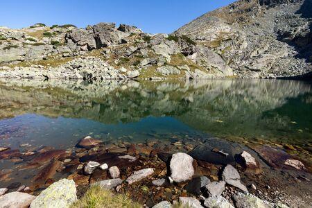 Amazing landscape of The Scary lake and Kupens peaks, Rila Mountain, Bulgaria