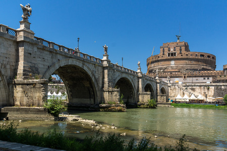 angels fountain: ROME, ITALY - JUNE 22, 2017: Amazing view of St. Angelo Bridge,  Tiber River and castle st. Angelo in city of Rome, Italy Editorial