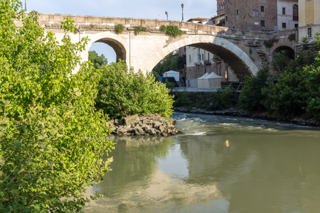 ROME, ITALY - JUNE 22, 2017: Amazing view of Castello Caetani, Tiber River and Pons Fabricius in city of Rome, Italy