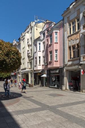 PLOVDIV, BULGARIA - SEPTEMBER 1, 2017:  People walk down a Knyaz Alexander I street in city of Plovdiv, Bulgaria Stock Photo - 87375406