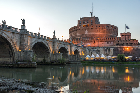 ROME, ITALY - JUNE 22, 2017: Amazing Sunset view of St. Angelo Bridge and castle st. Angelo in city of Rome, Italy