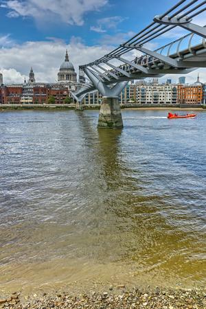 LONDON, ENGLAND - JUNE 15, 2016:  St. Pauls Cathedral and Millennium bridge, London, England, Great Britain
