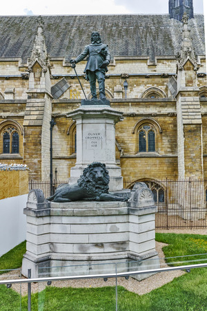 LONDON, ENGLAND - JUNE 15, 2016:  Oliver Cromwell Statue in front of Palace of Westminster,  London, England, Great Britain
