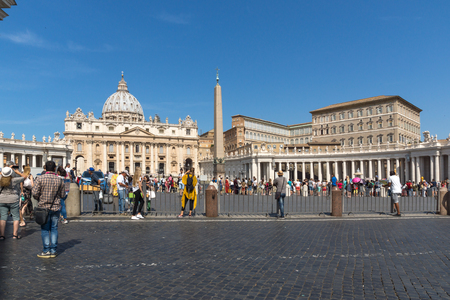 ROME, ITALY - JUNE 23, 2017: Tourists visit Saint Peters Square and St. Peters Basilica in Rome, Vatican, Italy