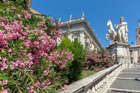 ROME, ITALY - JUNE 23, 2017: Statue and Flowers in front of Capitoline Museums in city of Rome, Italy Editorial