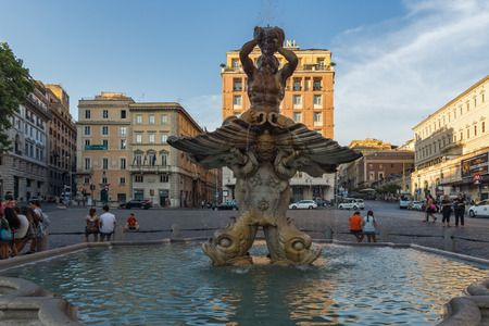 ROME, ITALY - JUNE 24, 2017: Sunset view of Triton Fountain at Piazza Barberini in Rome, Italy