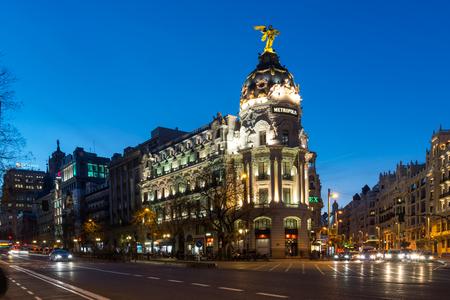 MADRID, SPAIN - JANUARY 23, 2018:  Sunset view of Gran Via and Metropolis Building in City of Madrid, Spain Editorial