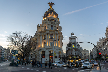 MADRID, SPAIN - JANUARY 23, 2018:  Sunset view of Gran Via and Metropolis Building in City of Madrid, Spain Editorial