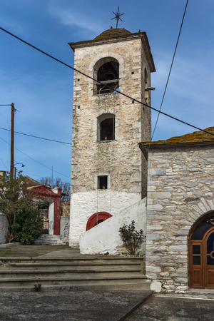 Bell Tower of Orthodox church with stone roof in village of Theologos,Thassos island, East Macedonia and Thrace, Greece Фото со стока