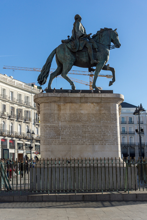 MADRID, SPAIN - JANUARY 22, 2018:  Equestrian Statue of Carlos III at Puerta del Sol in Madrid, Spain