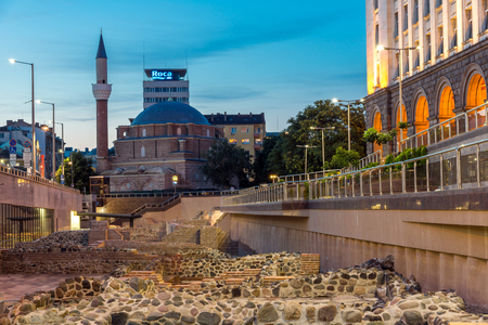 SOFIA, BULGARIA - JULY 21, 2017: Night photo of Banya Bashi Mosque and ruins of ancient Serdica in Sofia, Bulgaria