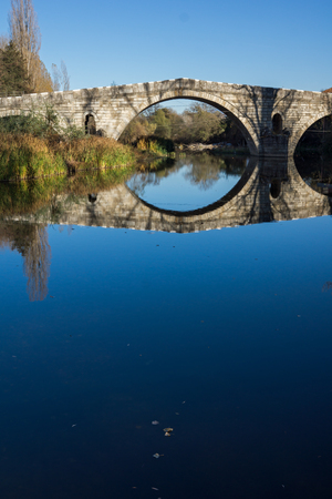 Autumn view of Kadin most - a 15th-century stone arch bridge over the Struma River at Nevestino, Kyustendil Province, Bulgaria