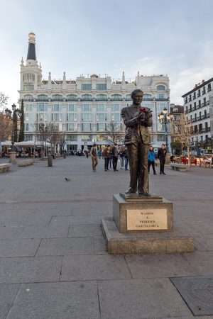 MADRID, SPAIN - JANUARY 23, 2018: Sunset view of Monument of Federico Garcia Lorca at Plaza Santa Ana in City of Madrid, Spain