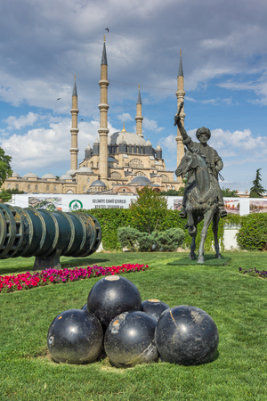EDIRNE, TURKEY - MAY 26, 2018:  Monument of Ottoman Sultan Mehmed II with medieval cannon in city of Edirne,  East Thrace, Turkey Editorial