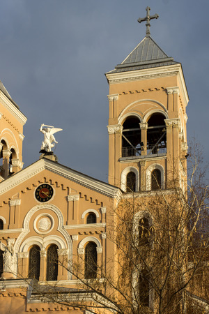 RAKOVSKI, BULGARIA - DECEMBER 25, 2013: Sunset view of The Roman Catholic church of St Michael the Archangel in town of Rakovski, Bulgaria