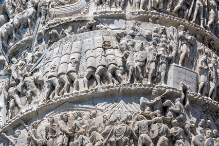 Architectural detail from of ancient Marcus Aurelius Column in front of Palazzo Chigi in city of Rome, Italy