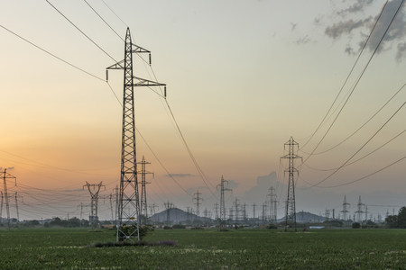 Amazing Sunset view over High-voltage power lines in the land around city of Plovdiv, Bulgaria