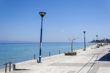 CHANIOTIS, KASSANDRA, GREECE - MARCH 31, 2019: Beach of Village of Chaniotis at Kassandra Peninsula, Chalkidiki, Central Macedonia, Greece Editorial