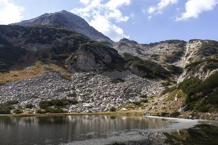 Autumn landscape of Muratovo (Hvoynato) lake at Pirin Mountain, Bulgaria
