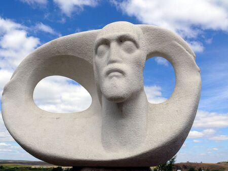 sculpture of a man in historic landscape museum-reservation Arkaim