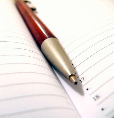 Open notebook with a pen Stock Photo