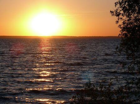 Golden romantic sunset in the lake