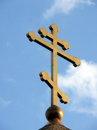 Ortodoxal cross in the blue sky background