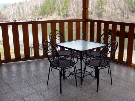 Metal table and four chairs in the balcony