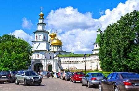 Istra, Russia - June 05, 2010  Summer day  People  walks near the tower of New Jerusalem monastery on June 05, 2010 in Istra, Moscow area, Russia Editorial
