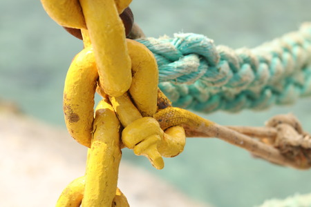 Closeup of rope and chain Stock Photo