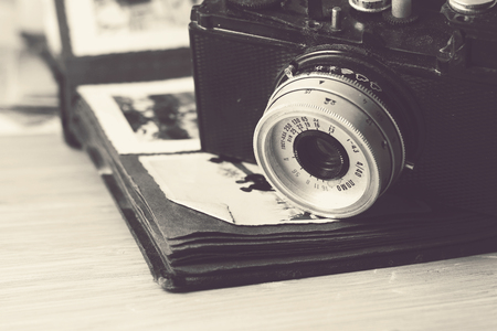 photo album: Photo camera and an album