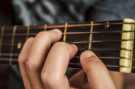 entertainers: Fingers on guitar