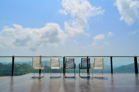 chair garden: Magnificent outdoor terrace with chairs on sunny terrace with bay view and decoration in contemporary home.