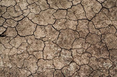 Tierra seca. Fondo agrietado suelo.