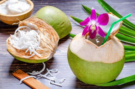 Freshly cut coconut fruit ready to drink Has a sweet and fragrant flavor and have coconut flesh in the coconut shell to eat. Stock Photo