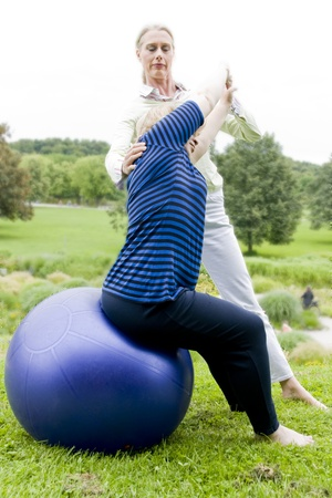 Physiotherapy with ball outdoors Stock Photo