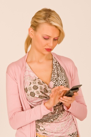 Woman when typing a number on the mobile phone Stock Photo - 10064599