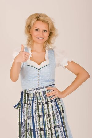 Bavarian Dirndl girls, thumbs up Stock Photo - 10401741