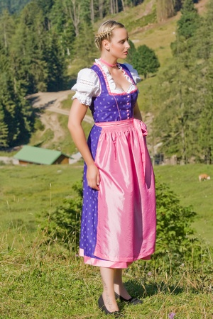 wiesn:  Beautiful girl on a Bavarian alpine meadow in the mountains