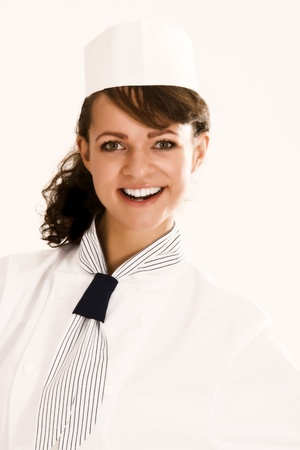 Portrait of a female, smiling chef apprentice