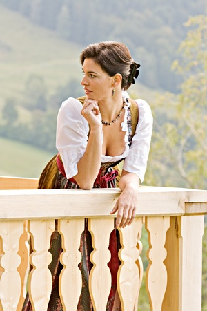 Bavarian girl in Holiday costume sitting on a bench Stock Photo - 10486660