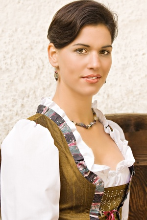 Bavarian girl in Holiday costume sitting on a bench Stock Photo - 10487081