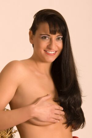 Portrait of a naked woman covered with the hand your chest Stock Photo - 10486703