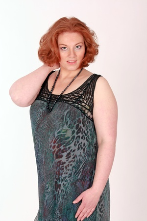 Plus Size Model with red hair in fashionable clothing photo