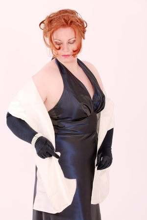 Elegant young redheaded Plus Size Model in black evening dress Stock Photo